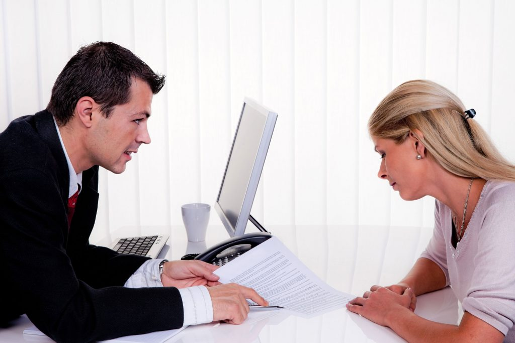 Office Professionals Discussing Document