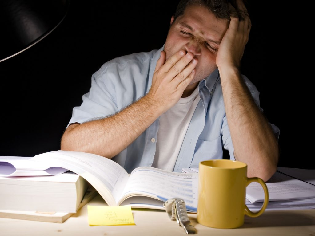 Man Tired Studying OREA Textbook