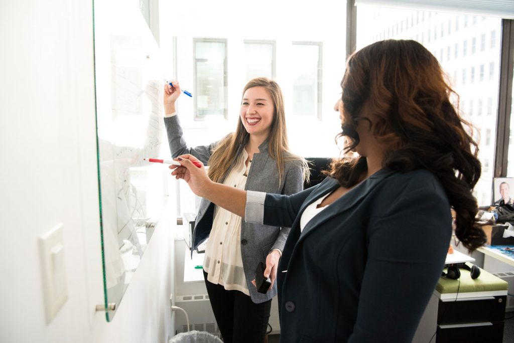 Two Ontario Real Estate Salespeople at a Whiteboard